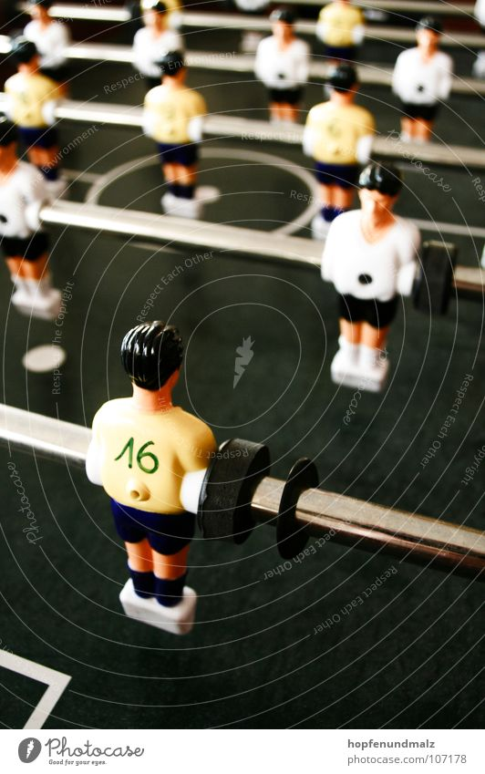 off Table Break Fraud Kick off Sports Playing Individual Soccer player 16 Table soccer Rod Shallow depth of field Colour photo Rear view Side by side