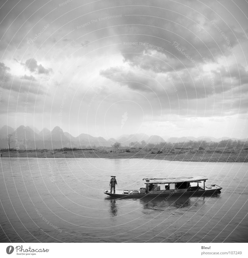 Li.yang China Guilin Chinese Black & white photo Asia Water li-yang storm boat landscape mountains grey