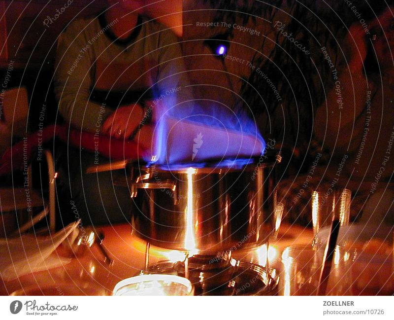 fiery Sugar Party Wine Flame Mulled wine High-grade steel Pot Cooking Cozy Hot drink Accessible Winter mood Interior shot Bluish Sugar loaf Feuerzangenbowle
