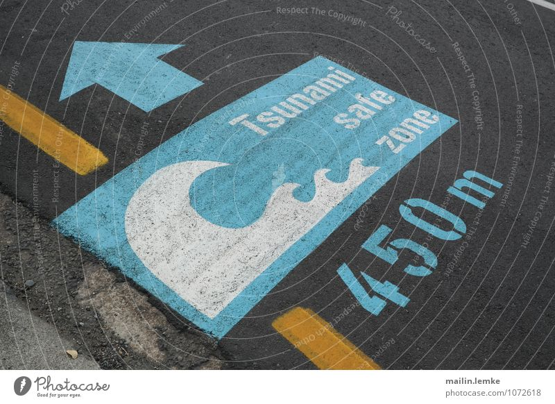 Tsunami safe zone Sign Characters Digits and numbers Signs and labeling Signage Warning sign Large Blue Yellow Black Safety Pavement Colour photo Multicoloured