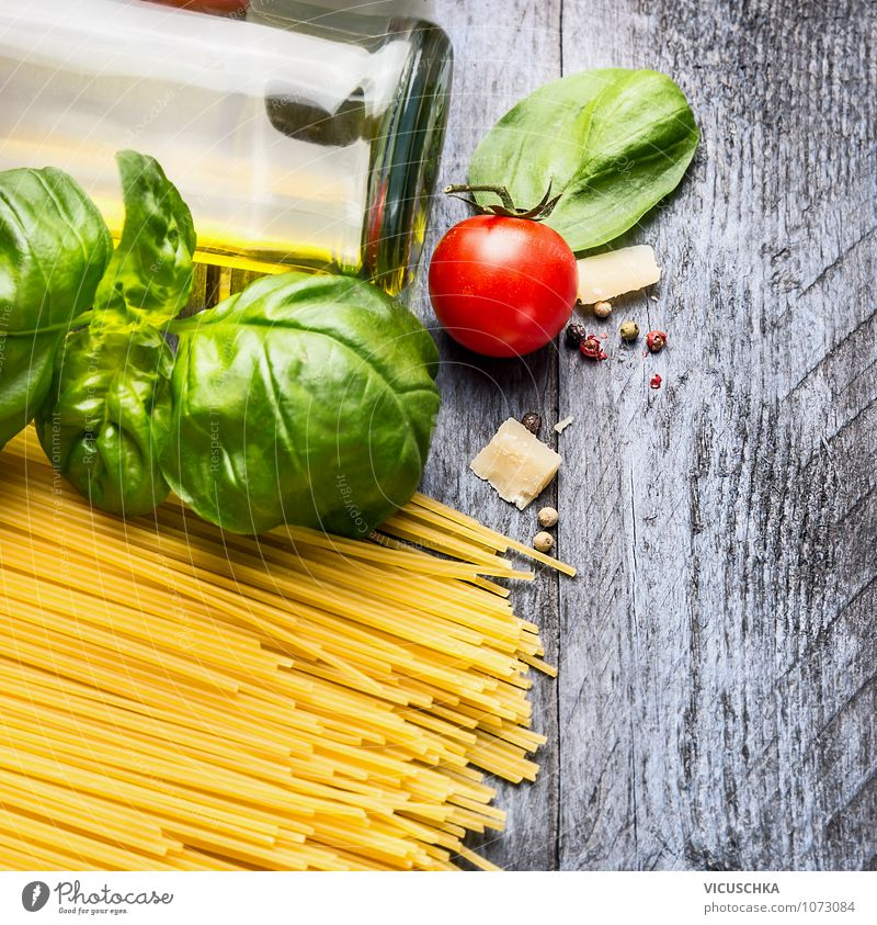 Spaghetti ingredients on a blue wooden table Food Vegetable Dough Baked goods Herbs and spices Cooking oil Nutrition Lunch Organic produce Vegetarian diet Diet