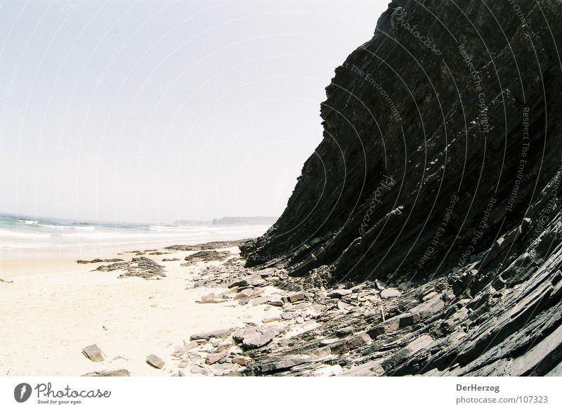 Stony ascent Beach Fisheye Granite Black Incline Deserted Ocean Waves Portugal Summer Stone Rock Sand Shift work Mountain
