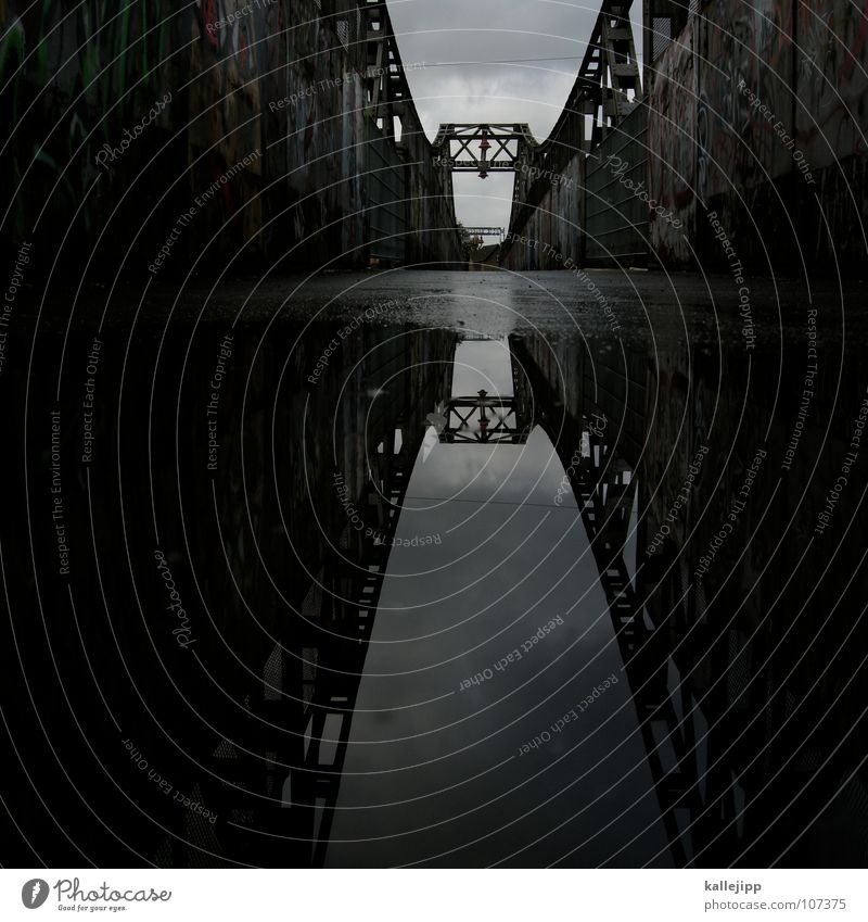 X Suspension bridge Construction Puddle Reflection Bridge Mirror image Water reflection Water puddle Surface of water Silhouette Central perspective Dark