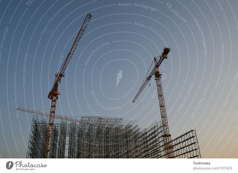 Construction site in the sky Crane Twilight Scaffold Grating Parallel Steel Industry Craft (trade) Sporting event Competition Sky Evening Blue parallelisms