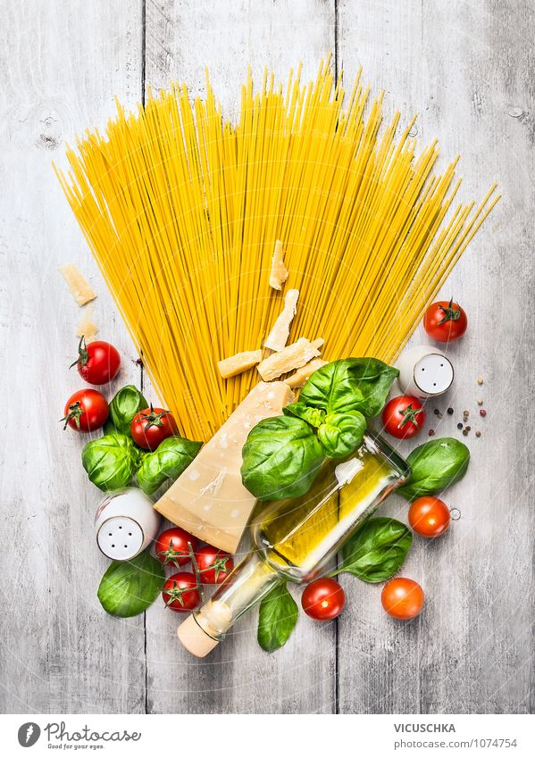 Spaghetti and ingredients for tomato sauce Food Vegetable Dough Baked goods Herbs and spices Cooking oil Nutrition Lunch Dinner Organic produce Vegetarian diet