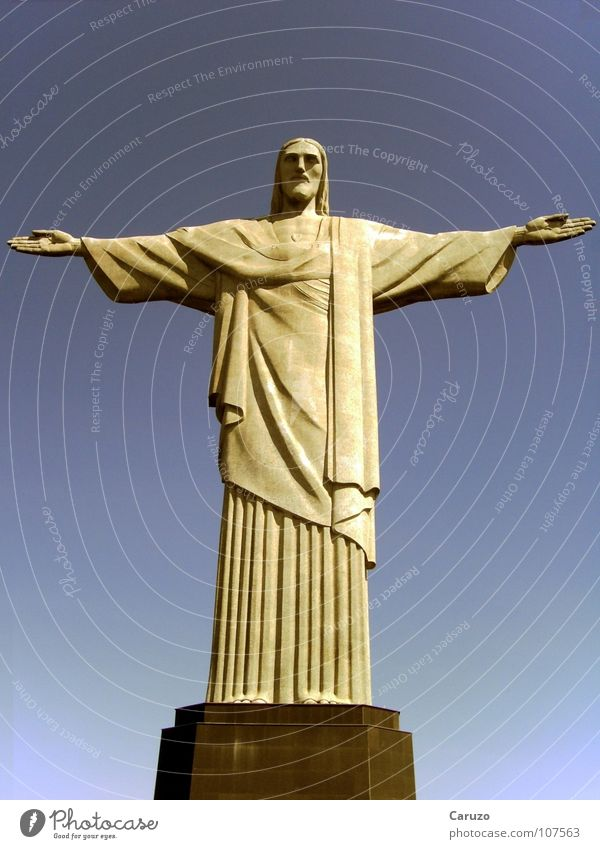Blue Death Freedom Lanes & trails Stone Religion and faith Power Brazil Open Might Peace Monument Statue Landmark God Crucifix