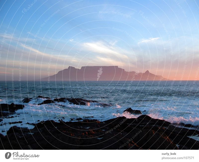 Table Mountain in Cape Town Clouds Reef Table mountain South Africa Sunset Fresh Vantage point Beach Coast Sky Rock Dusk Water Far-off places Island