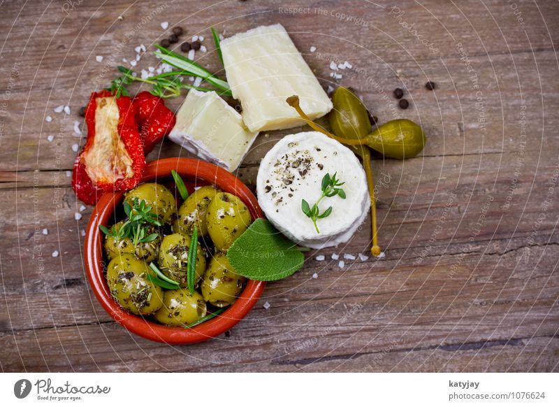 Cheese and olives Olive Olive oil camembert Parmesan soft cheese Goat`s cheese Rosemary Caper Appetizer Dessert Antipasti pickled Green Tomato Herbs and spices