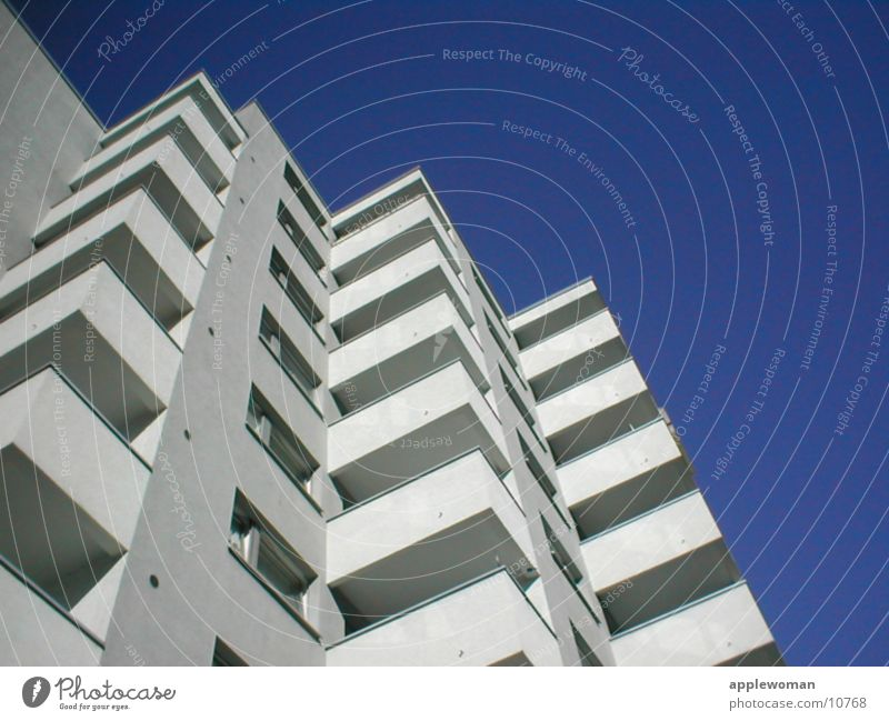 block of flats Schöneberg Tower block Balcony White Concrete Worm's-eye view Architecture Graffiti Prefab construction Blue sky Escape