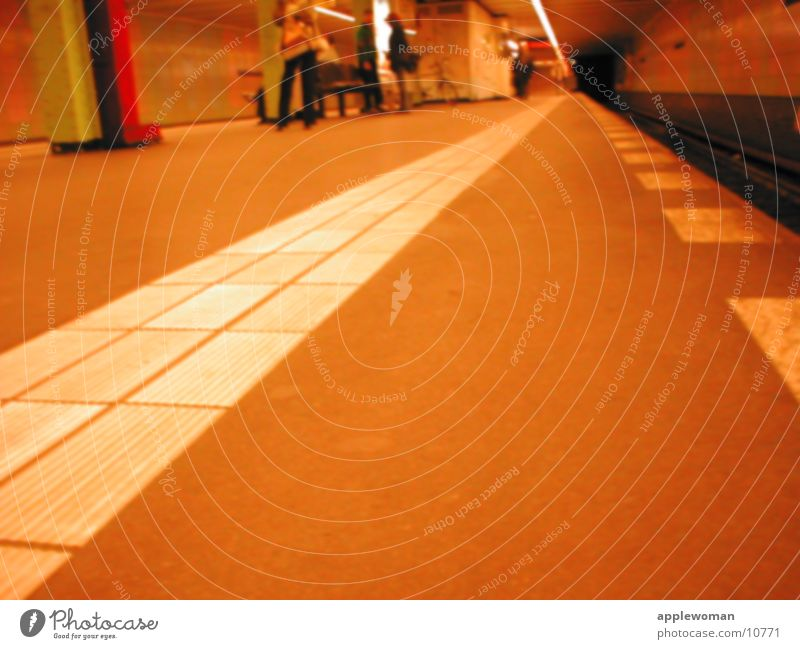 berlin_underground Underground Platform Worm's-eye view Edge Railroad tracks Architecture Berlin Evening Floor covering flow over the ground Orange