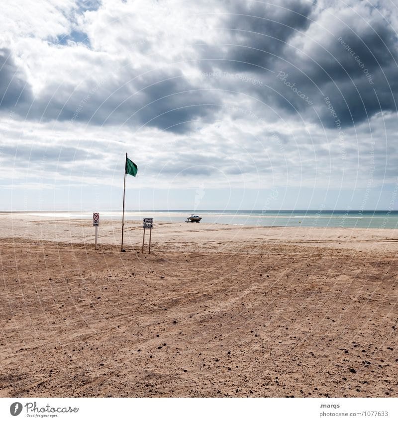 Weather Vacation & Travel Far-off places Environment Nature Elements Sky Storm clouds Horizon Summer Climate Bad weather Wind Beach Signs and labeling Flag