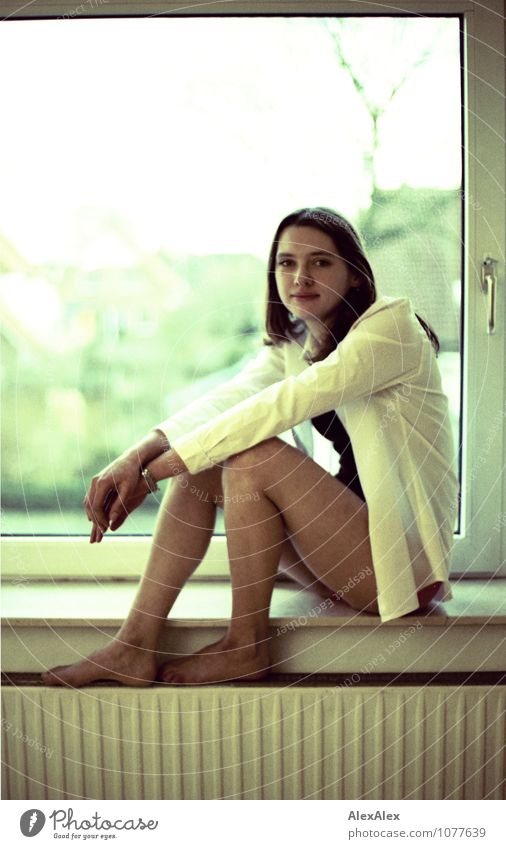 window seat Flat (apartment) Room Window Young woman Youth (Young adults) Legs Feet 30 - 45 years Adults Jacket Barefoot Brunette Long-haired Heater Window seat