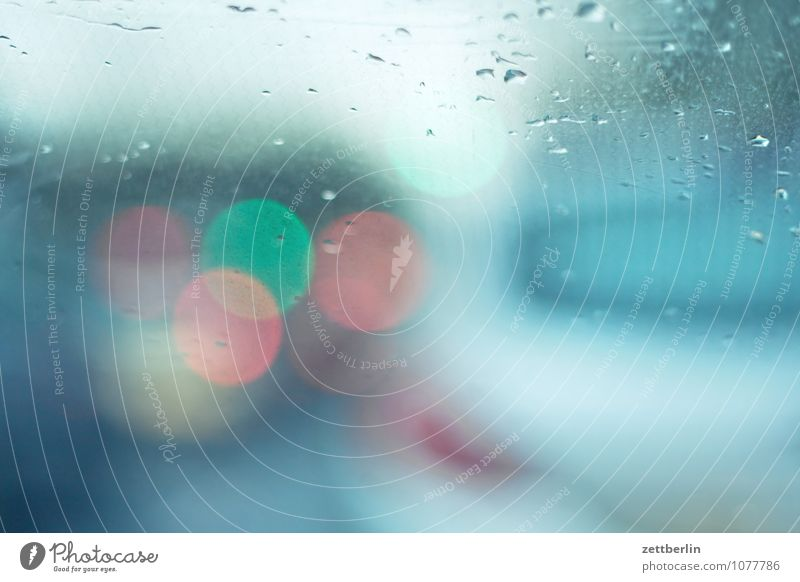 Driving on sight Car Mobility Rain Drops of water Precipitation Window Car Window Window pane Windscreen Light Rear light Traffic light Shallow depth of field