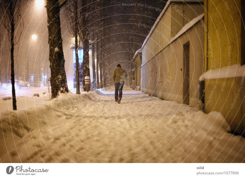 out and about at night Human being Masculine Man Adults 1 Winter Weather Storm Snow Snowfall Munich Town Wall (barrier) Wall (building) Pedestrian Street