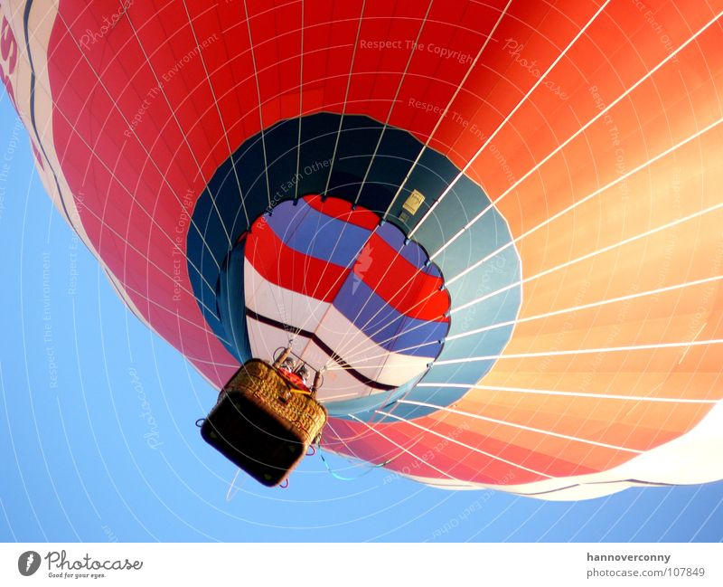 The red balloon Zeppelin Clouds Weightlessness Red Basket Glide Glider flight Hover Ease Ascending Gale Evening sun Contentment Leisure and hobbies Aviation Sky