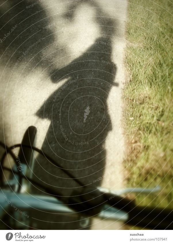 ... another shadow-wheeler ... Drop shadow Bicycle Asphalt Wayside Grass Green Take a photo Leisure and hobbies Shadow Brakes Bicycle handlebars metal bar