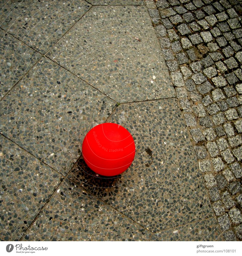 stayed behind Balloon Red Air Gray Lie Round Traffic infrastructure Colour Flying Street Cobblestones Stone
