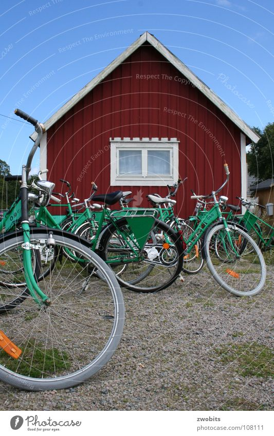 Hej cyklar! Bicycle Wooden house House (Residential Structure) Red Green Bike Rental Shop Playing Leisure and hobbies Transport Sweden Sky Blue Wait rental