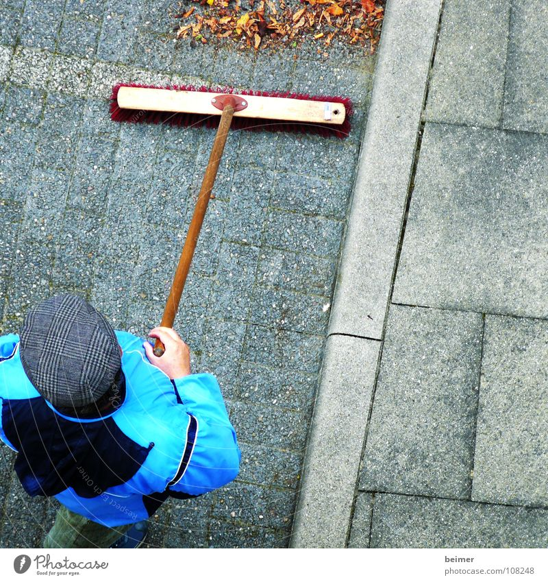 Caretaker II Broom Sweep Bristles Pave Parking lot Leaf Cap Man Janitor Autumn Work and employment Clean Cleaning Services cobblestones Lanes & trails Weather
