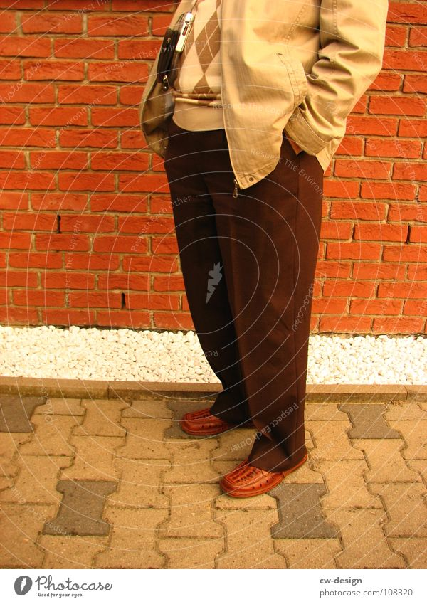 Human being Man Old House (Residential Structure) Cold Senior citizen Stone Legs Footwear Elegant Wait Stand Brick Media Pants