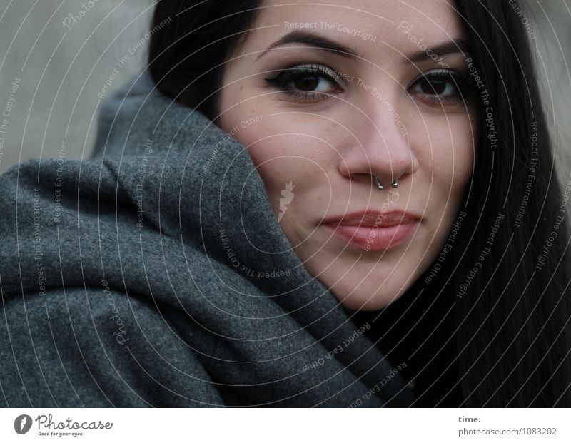 . Feminine Young woman Youth (Young adults) 1 Human being Coat Piercing Black-haired Long-haired Observe Smiling Looking Wait Elegant Beautiful Contentment