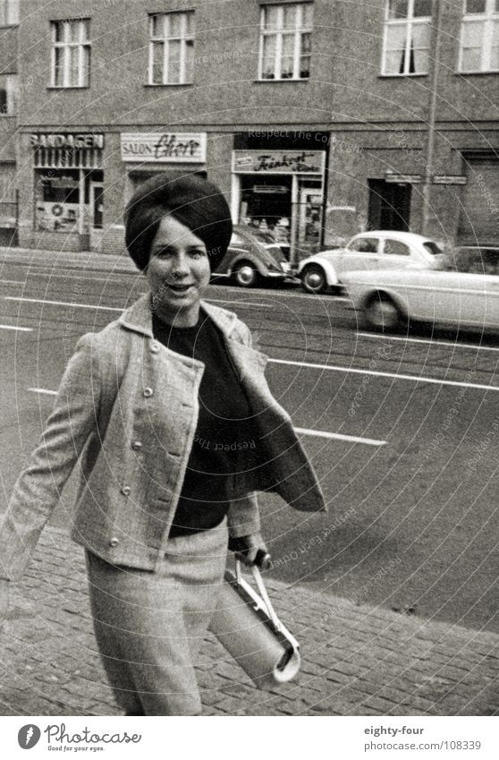 mama, who is having a rabble-rousing effect on the photographer. Sixties Black White Retro Hair and hairstyles Brunette Snapshot Pedestrian Black & white photo