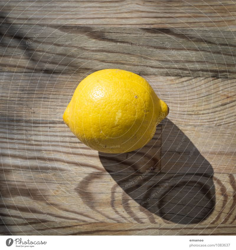 lemon Food Fruit Nutrition Organic produce Vegetarian diet Diet Juice Healthy Wellness Fragrance Table Kitchen Wood Glittering Round Sour Brown Yellow Lemon