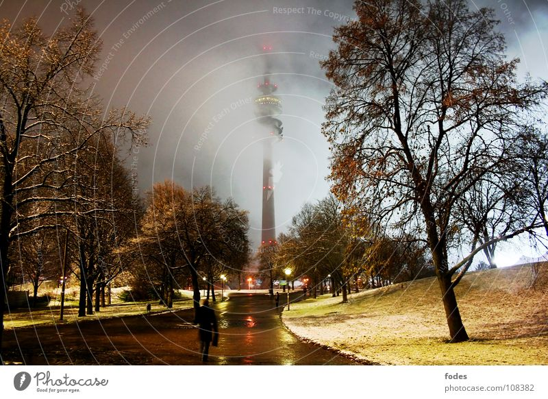 winter night Olympic Tower Television Pedestrian Speed Wet Munich Europe Bavaria Park Dark Illuminate Street lighting Light Night Fog Comfortless Cold Winter