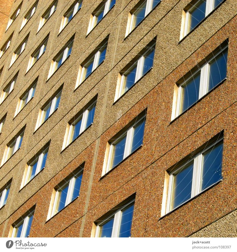 inconspicuous façade Architecture Prefab construction Facade Window Sharp-edged Hideous Gloomy Brown Norm Geometry Consecutively Classification GDR Diagonal