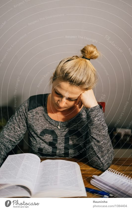 Human being Youth (Young adults) Young woman Adults Feminine Gray Think Hair and hairstyles Head Flat (apartment) Living or residing Blonde Sit Table Book Study