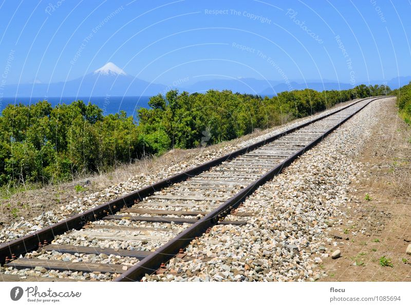 Railroad in front of volcano Osorno and lake Llanquihue Sky Nature Vacation & Travel Beautiful Summer Sun Mountain Snow Lake Rock Watercraft Park Tourism Action
