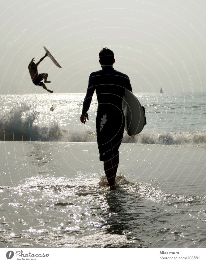 Water Ocean Summer Beach Black Sports Emotions Jump Playing Waves Action Leisure and hobbies France Dynamics Surfer Afternoon