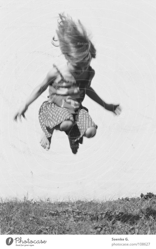 jump Child Girl Jump Wall (barrier) Meadow Playing Dream Hippie Romp Joy Black & white photo Hair and hairstyles Tall Shadow little child daydream