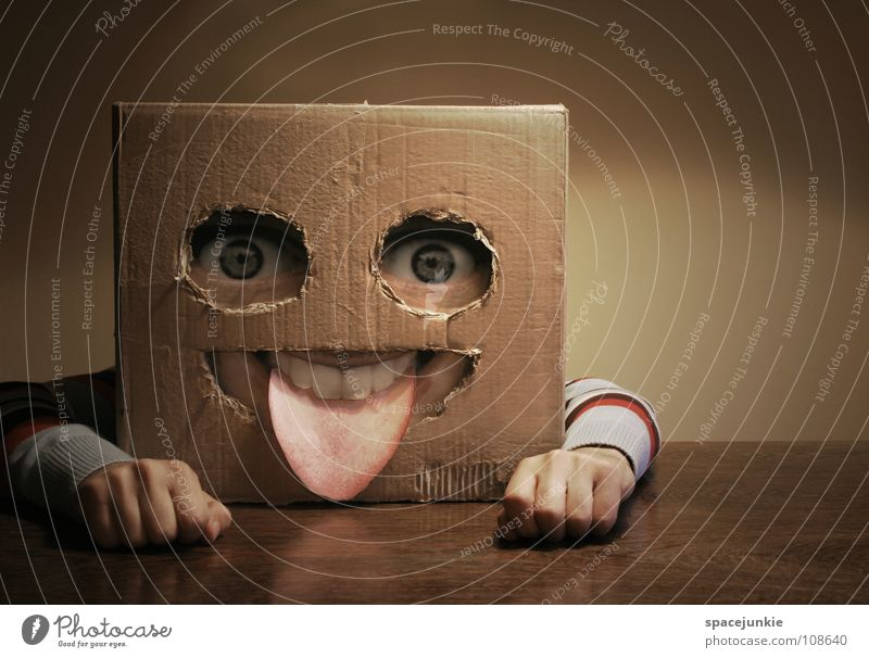Square skull at home Man Cardboard Whimsical Humor Wall (building) Freak Table Wood Hand Joy Face Mask Tongue Hiding place Hide Arm Table edge Tabletop