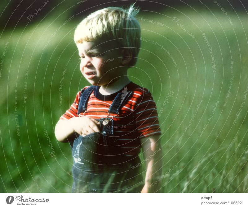 Child on a green meadow Masculine Toddler Boy (child) Body Head 1 Human being 1 - 3 years To enjoy Smiling Emotions Moody Joy Happy Happiness Contentment