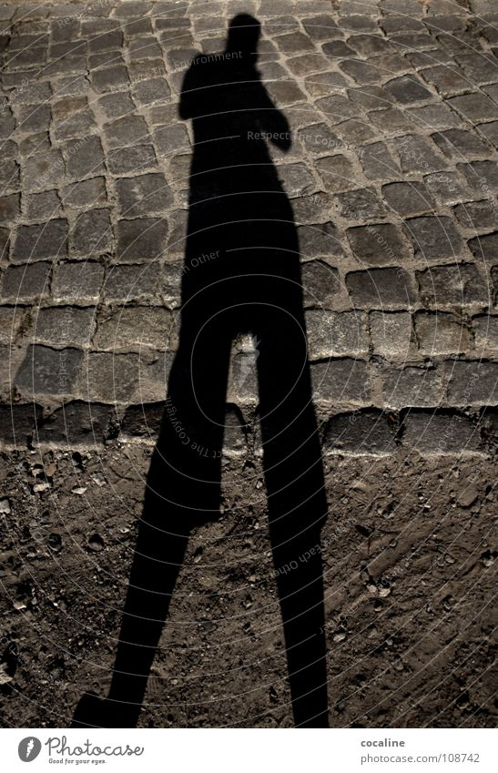 Mistress long leg Shadow play Drop shadow Silhouette Light Earth colour Colossus Ghosts & Spectres  body outline Sand Street Cobblestones Stone Lanes & trails