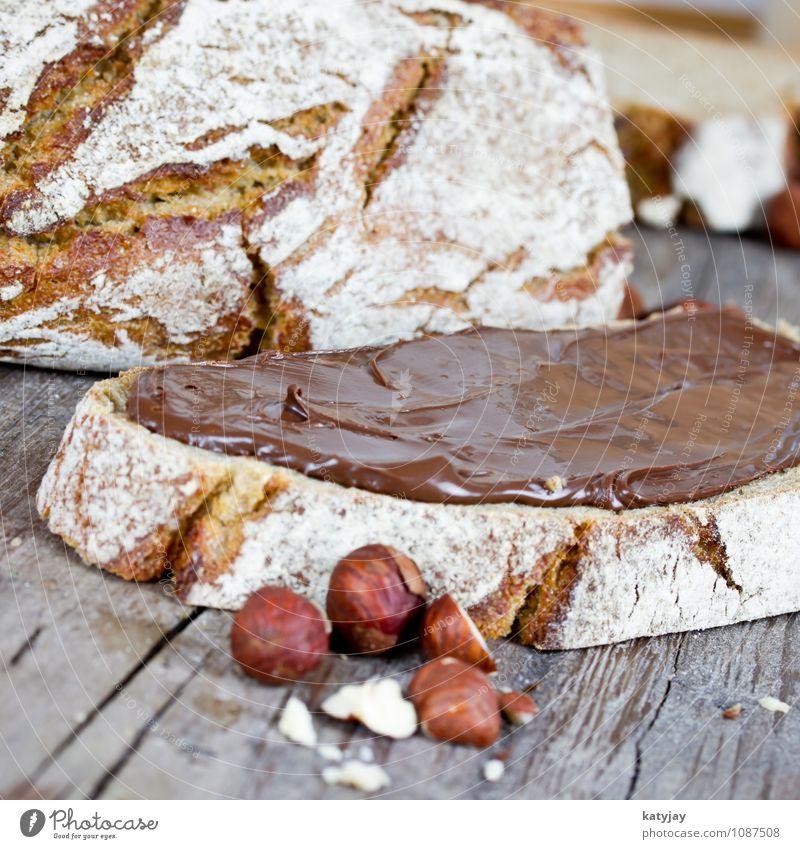 hazelnut cream Bread Hazelnut Nut spread Spread Breakfast Chocolate Cream Slice Nutrition coarse rye bread Dessert Baker Fresh Rye Sandwich Wooden table Baking