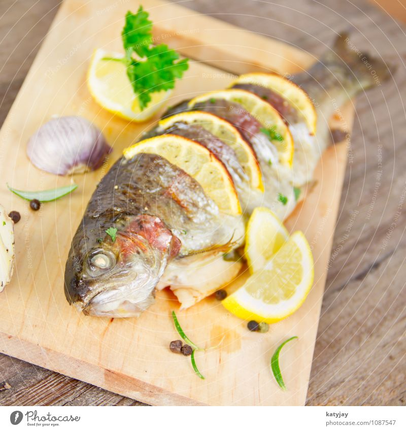 grilled trout Trout Fish Roasted Cooking Lemon Barbecue (apparatus) Barbecue (event) Summer Fresh Parsley Rosemary Garlic Clove of garlic Nutrition Protein