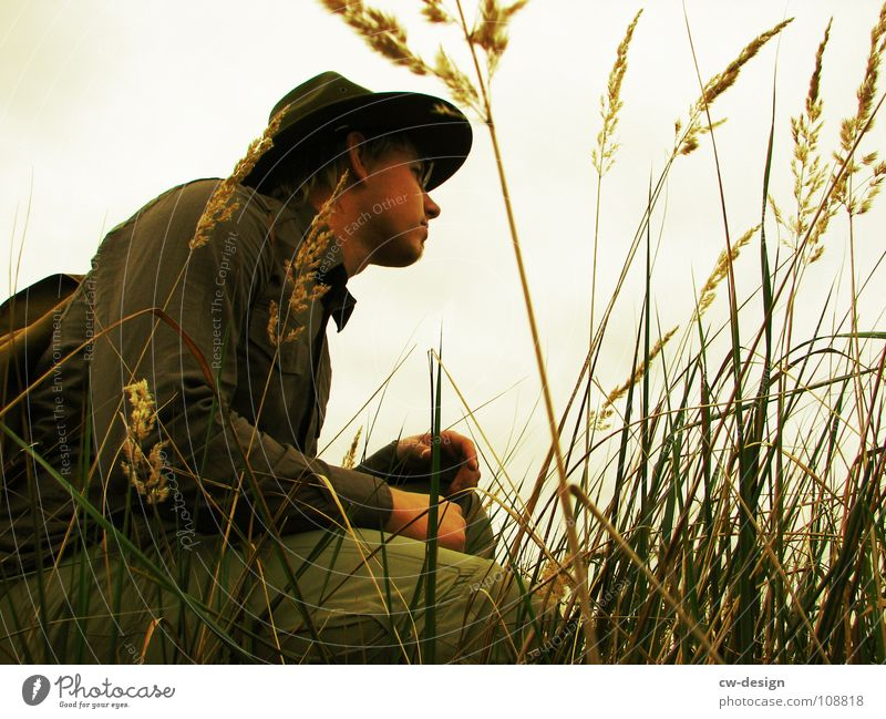 Human being Man Vacation & Travel Tree Loneliness Clouds Dark Meadow Grass Stone Sadness Horizon Rock Field Sit Masculine