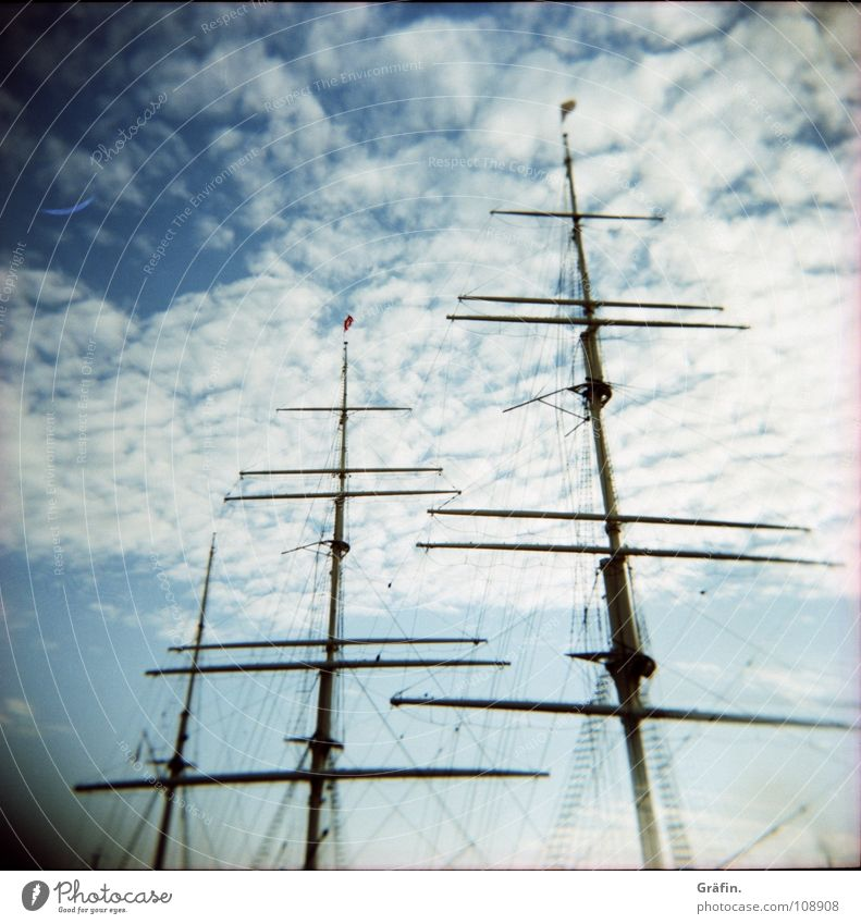 windy Holga Clouds Watercraft Sailing ship Cargo-ship Steel Stern Port side Starbord Windjammer Captain Driving Longing Harbour Lomography Sky bark