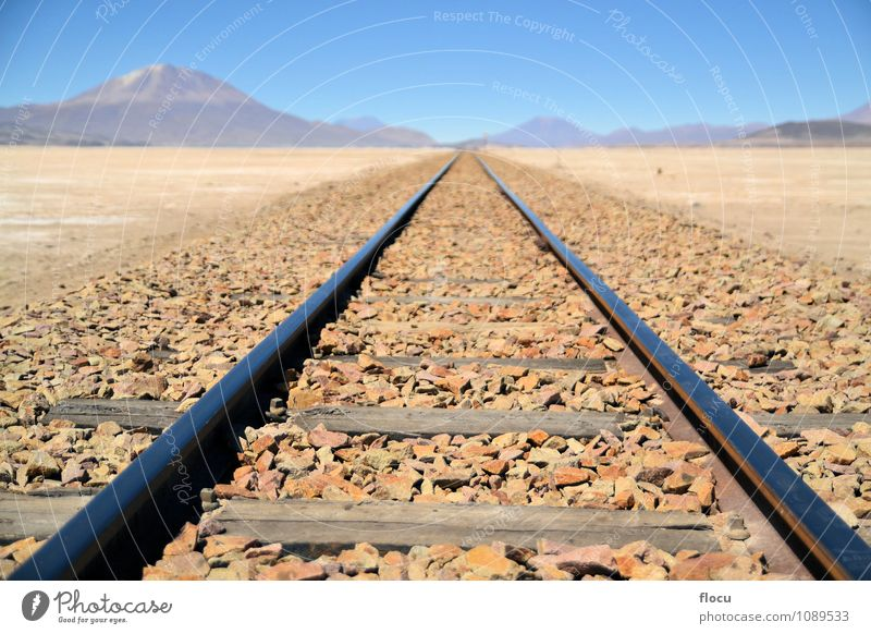 Endless train tracks in the desert with a volcano Vacation & Travel Trip Mountain Nature Landscape Sand Sky Horizon Volcano Transport Lanes & trails Railroad