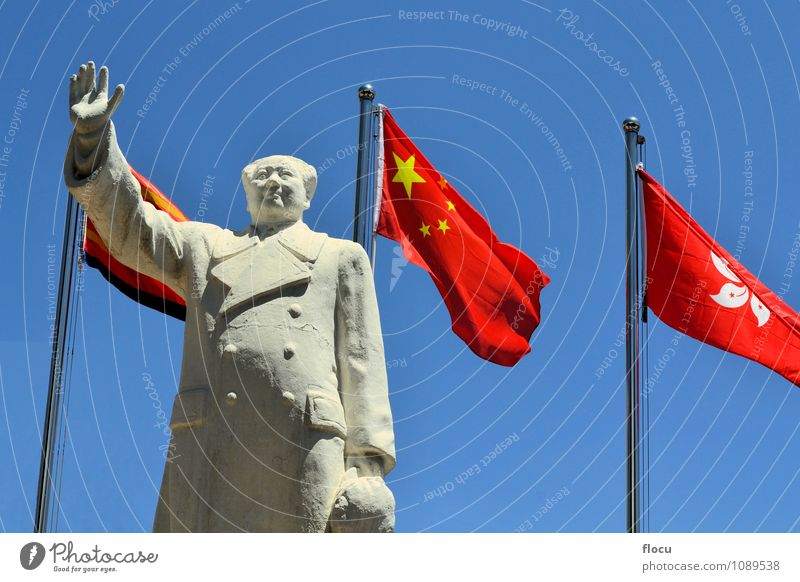 Chairman Mao Zedong with Chinese flag Hand Sky Flag Historic Blue Red Politics and state chairman China chinese Communism Communist famous Leader president