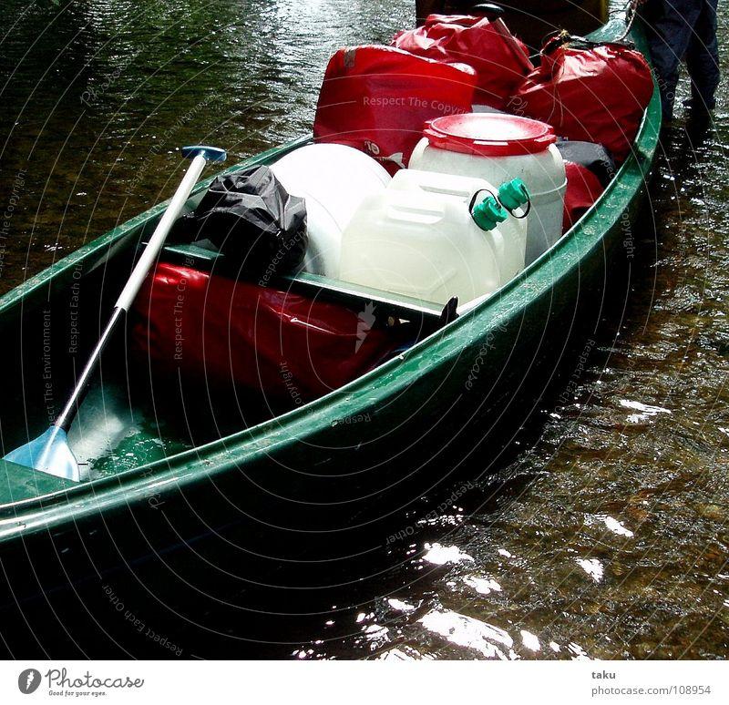 WHO LOVES HIS CANOE, PUSHES. June Canoe trip Work and employment Paddle Water can Life jacket Rain jacket Push Effort String Aquatics Poland Masuria packsacks