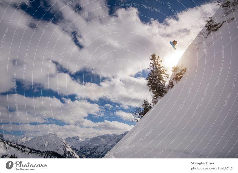 Over jump Sports Winter sports Sportsperson Deep snow Human being Masculine 1 Nature Landscape Sky Clouds Sun Sunlight Beautiful weather Tree Rock Alps Mountain