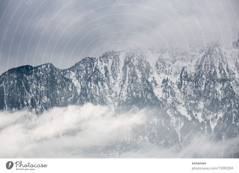 Sky Nature Vacation & Travel Landscape Clouds Far-off places Winter Mountain Snow Rock Ice Tourism Weather Air Fog Wind