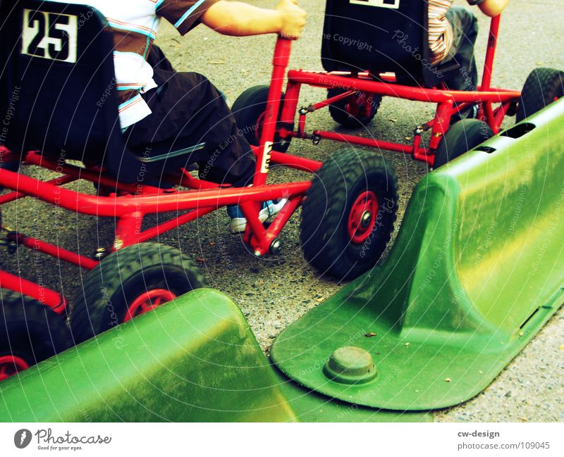 at full throttle! I Child Playground Playing Driving Stand Sandpit Sporting grounds Traffic lane Racecourse Stop Signage Warning sign Roadside Lane markings