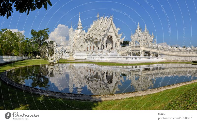 Beautiful ornate white Thai temple reflecting in water Sky Nature Vacation & Travel Blue White Tree Architecture Lanes & trails Building Religion and faith Art