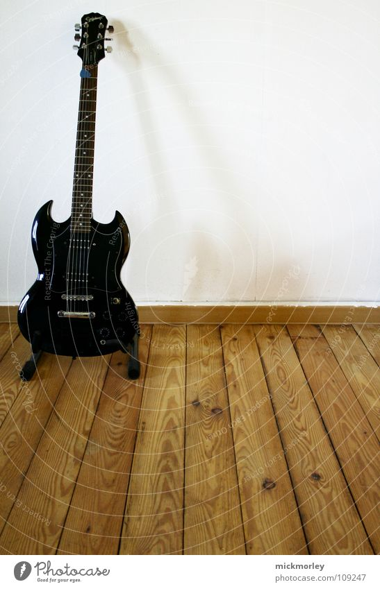 White Black Wall (building) Wood Music Floor covering String Concert Rock music Guitar Musical instrument Musical instrument string Wooden floor Electric Thread