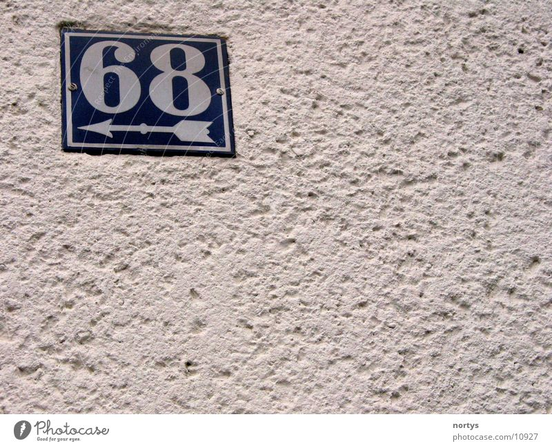 <___68 House number Digits and numbers Wall (building) sixty