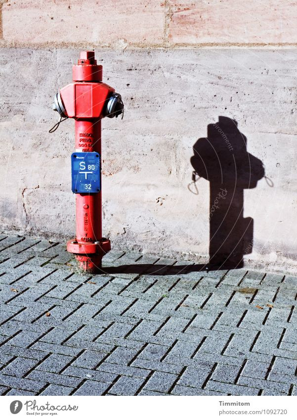 Stand by me. Wall (barrier) Wall (building) Fire hydrant Concrete Metal Line Sharp-edged Firm Clean Blue Gray Red Black Emotions Shadow Places Paving stone